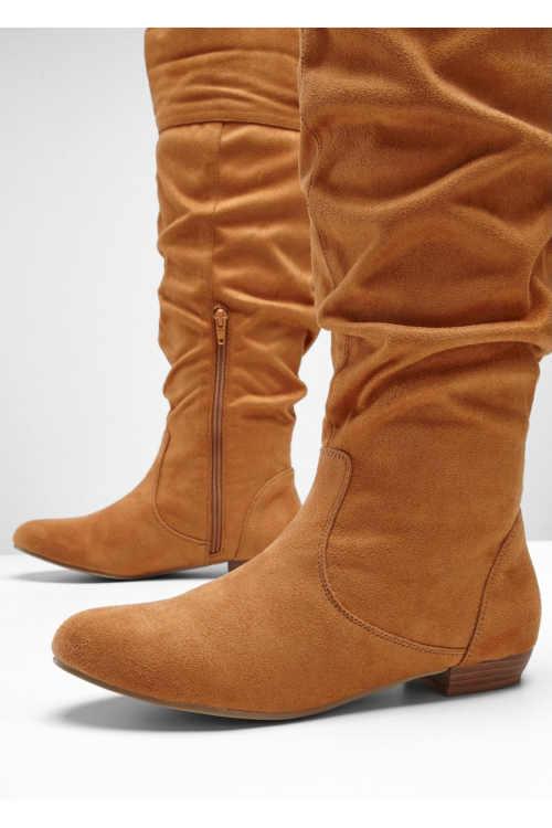 Nowoczesne, wyższe buty damskie